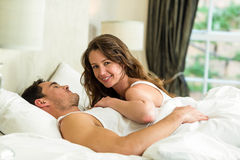 Young couple cuddling on bed Stock Photo