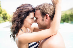Young couple cuddling each other near pool Royalty Free Stock Image