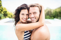 Young couple cuddling each other near pool Stock Image