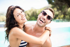 Young couple cuddling each other near pool Stock Photography