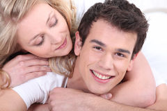 Young couple cuddling Stock Photography