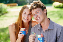 Young couple with a cup of ice cream in summer Royalty Free Stock Photography