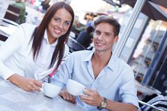 Young couple with cups Royalty Free Stock Photos