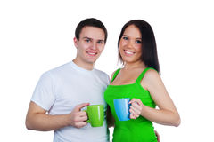 Young couple with a cups of tea Royalty Free Stock Image
