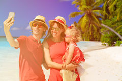 Young couple with cute little daughter making a Royalty Free Stock Image