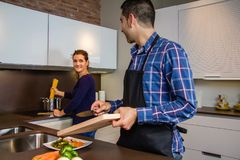 Young couple cutting vegetables in the kitchen Royalty Free Stock Image