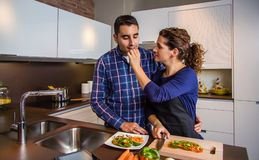 Young couple cutting vegetables in the kitchen Royalty Free Stock Photography