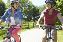 Young Couple On Cycle Ride In Countryside Royalty Free Stock Photo