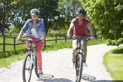 Young Couple On Cycle Ride In Countryside Royalty Free Stock Images