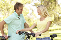 Young Couple On Cycle Ride in Park Stock Photos