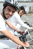 Young couple cycling Royalty Free Stock Images