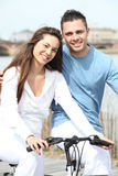 Young couple cycling Royalty Free Stock Photography