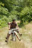 Young couple cycling. Man and woman riding a bicycle, having fun Royalty Free Stock Photos