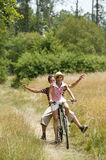 Young couple cycling. Man and woman riding a bicycle, having fun Stock Photography