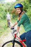 Young Couple Cycling Along Country Track Royalty Free Stock Photography