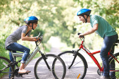 Young Couple Cycling On Country Road Stock Photo