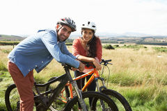 Young Couple Cycling In Countryside Royalty Free Stock Photos