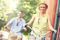 Young couple cycling together in the city. A picture of a young couple cycling in the city royalty free stock photo