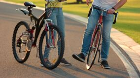 Young couple of cyclists having fun. stock video footage