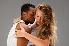 Young couple dances Caribbean Salsa. Studio shot royalty free stock photography