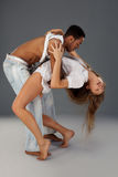 Young couple dances Caribbean Salsa. Studio shot stock images