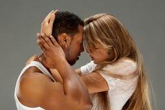 Young couple dances Caribbean Salsa. Studio shot Royalty Free Stock Image