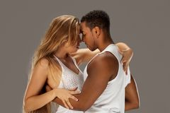 Young couple dances Caribbean Salsa. Studio shot Royalty Free Stock Images