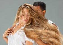 Young couple dances Caribbean Salsa. Studio shot Stock Images
