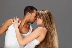 Young couple dances Caribbean Salsa. Studio shot royalty free stock photos