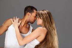Young couple dances Caribbean Salsa. Studio shot Royalty Free Stock Photos