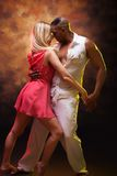 Young couple dances Caribbean Salsa Stock Photos