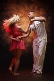 Young couple dances Caribbean Salsa Royalty Free Stock Image