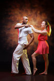 Young couple dances Caribbean Salsa Stock Photo