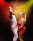 Young couple dances Caribbean Salsa Stock Image