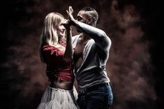 Young couple dances Caribbean Salsa. Young and couple dances Caribbean Salsa. Vintage Style Toned Picture stock photos