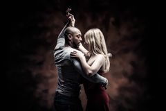 Young couple dances Caribbean Salsa Stock Photos