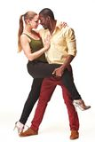 Young couple dances Caribbean Salsa, studio shot Royalty Free Stock Images