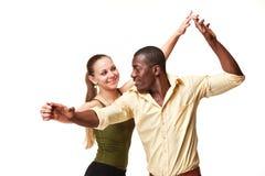 Young couple dances Caribbean Salsa, studio shot royalty free stock image
