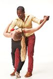 Young couple dances Caribbean Salsa, studio shot Royalty Free Stock Image