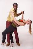 Young couple dances Caribbean Salsa, studio shot. Young couple dances social Caribbean Salsa, studio shot on white background. Positive human emotions. black stock photo