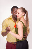 Young couple dances Caribbean Salsa, studio shot Stock Image
