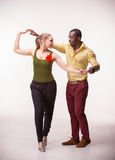 Young couple dances Caribbean Salsa, studio shot Stock Photography