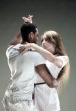 Young couple dances Salsa. Vintage photo. Young couple dances Caribbean Salsa, studio shot Stock Photography