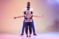 Young couple dances social Caribbean Salsa, studio shot Stock Photo
