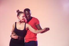 Young couple dances social Caribbean Salsa, studio shot Royalty Free Stock Image