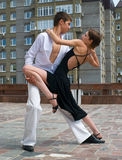 Young couple dancing. Latino dance against urban landscape Stock Photo