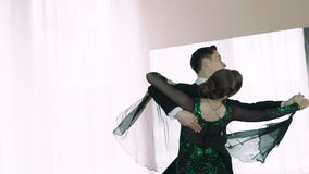 Young couple dancing ballroom dances in classic style. Slow motion stock video