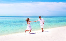 Young couple dancing on beach of tropical island Royalty Free Stock Photo