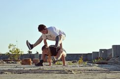 Young couple dancing break dance on the street Stock Photos