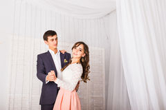 Young couple dancing in empty room Stock Images